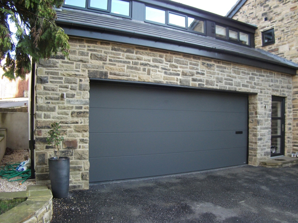 Two storey stone extension to make large triple garage and self contained studio apartment.